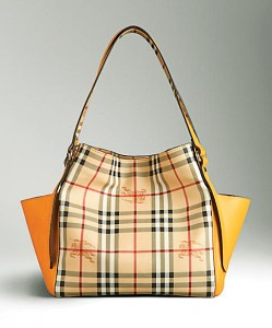 Check-mate Best known for iconifying the tartan print, British brand Burberry is  your go-to store for this Scottish weave.  This Hay market check tote bag in coated canvas features distinctive side pockets in supple nappa leather. The leather straps make it versatile and we suggest you match your shoes to make a complete statement. `41,685. At the store in Express Avenue. Details: 28464125/35