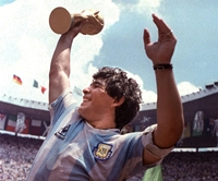 Diego Maradona raises the World Cup trophy after A