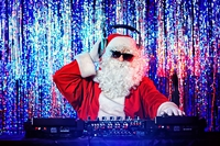 DJ Santa Claus mixing up some Christmas cheer. Disco lights in t