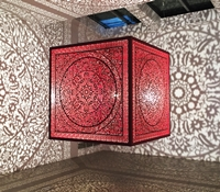 'All The Flowers Are For Me: Red' (laser-cut stainless steel and bulb) by Anila Quayyum Agha